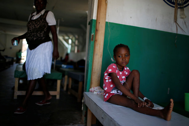 A girl is being treated at the cholera treatment center at the hospital after Hurricane Matthew hit Jeremie, Haiti, October 15, 2016. (Photo by Carlos Garcia Rawlins/Reuters)