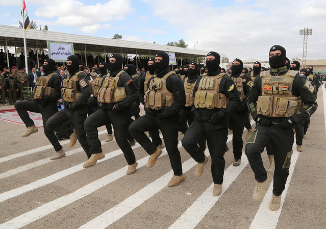 Iraqi police commandos march during a ceremony marking Police Day at the police academy in Baghdad, Iraq, Thursday, January 8, 2015. (Photo by Karim Kadim/AP Photo)