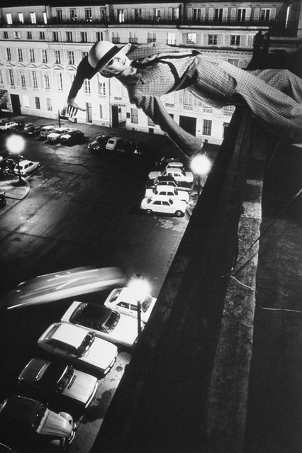 Mannequin Being Tossed Off Roof. (Photo by Helmut Newton)