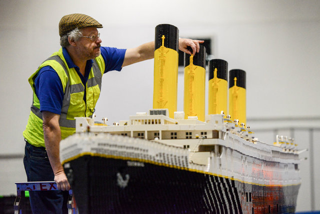 Lego builder Phil Traviss puts the finishing touches to his Titanic made out of 120,000 bricks over 3 months at ExCel on December 10, 2015 in London, England. Brick 2015 is an exhibition dedicated to Lego and runs at London's ExCel over three days starting on the 11th December. It features displays including Harry Potter, landmarks such as Big Ben and a dance music festival. (Photo by Chris Ratcliffe/Getty Images)