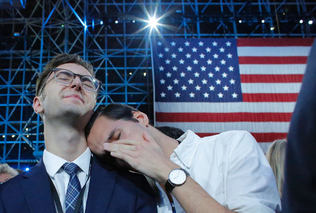 Supporters of Democratic presidential nominee Hillary Clinton react during election night at the Jacob K. Javits Convention Center in New York on November 8, 2016. (Photo by Kena Betancur/AFP Photo)