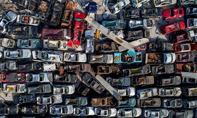 A picture taken with a drone shows imported and damaged vehicles at the destroyed port area at the six months mark since the day of the explosion, in Beirut, Lebanon, 03 February 2021. (Photo by Wael Hamzeh/EPA/EFE)