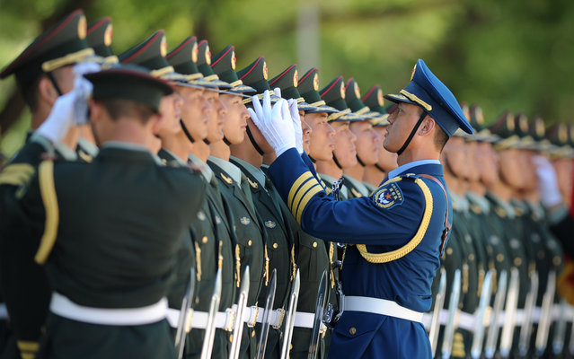 Chinese honour guards prepare for the arrival of Pakistani Prime Minister Nawaz Sharif during a welcoming ceremony outside the Great Hall of the People in Beijing on July 5,2013.  Sharif is on a visit to China from July 3 to 8. (Photo by Wang Zhao/AFP Photo)