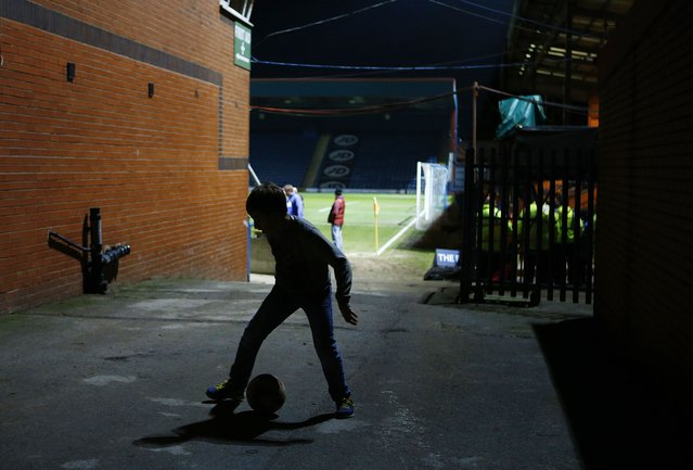 A boy plays football between the stands before Rochdale and Stoke City's English FA Cup 4th round soccer match at Spotland Stadium in Rochdale, northern England January 26, 2015. (Photo by Darren Staples/Reuters)