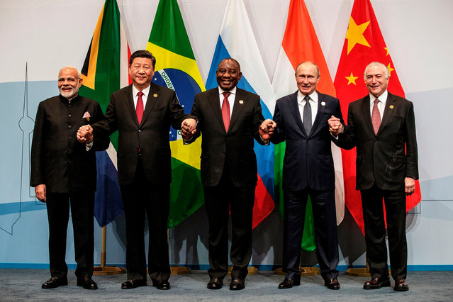 (L-R) India' s Prime Minister Narendra Modi, China' s President Xi Jinping, South Africa' s President Cyril Ramaphosa, Russia' s President Vladimir Putin and Brazil' s President Michel Temer pose for a group picture during the 10 th BRICS (acronym for the grouping of the world' s leading emerging economies, namely Brazil, Russia, India, China and South Africa) summit on July 26, 2018 at the Sandton Convention Centre in Johannesburg, South Africa. (Photo by Gianluigi Guercia/AFP Photo)