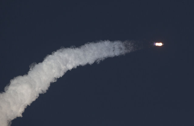 The unmanned Falcon 9 rocket, launched by SpaceX and carrying NOAA's Deep Space Climate Observatory Satellite, lifts off from launch pad 40 at the Cape Canaveral Air Force Station in Cape Canaveral, Florida February 11, 2015. (Photo by Scott Audette/Reuters)