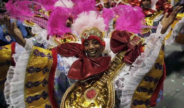 A reveller from Academicos do Tucuruvi Samba School takes part in a carnival at Anhembi Sambadrome in Sao Paulo February 14, 2015. (Photo by Nacho Doce/Reuters)