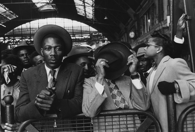Immigrants from the West Indies at Victoria Station in London, 1956. (Photo by Hulton-Deutsch Collection/CORBIS/Corbis via Getty Images)
