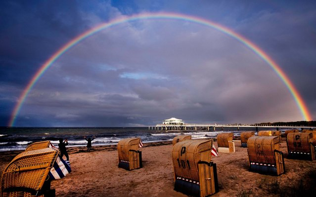 A rainbow appears over the Baltic Sea in Timmendorfer Strand, northern Germany, Saturday, October 5, 2019. (Photo by Michael Probst/AP Photo)
