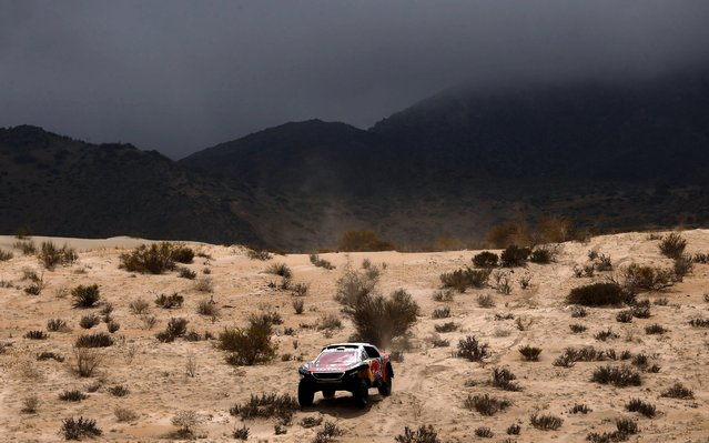 Stephane Peterhansel of France drives his Peugeot down a mountain during the 10th stage of the Dakar Rally 2016 near Fiambala, Argentina, January 13, 2016. (Photo by Marcos Brindicci/Reuters)