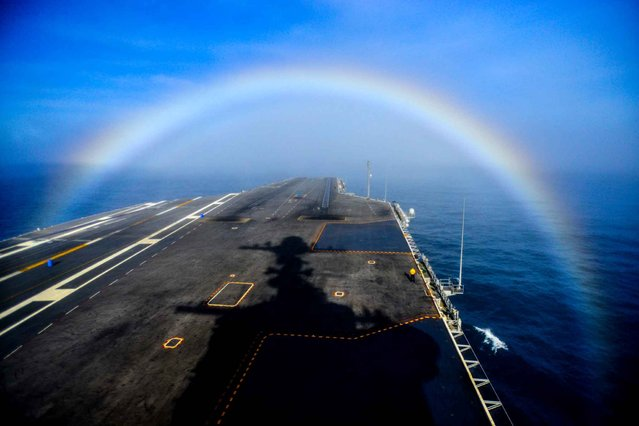 This US Navy photo obtained February 4, 2015 shows a rainbow as it forms over the bow of the Nimitz-class aircraft carrier USS John C. Stennis (CVN 74) on February 3, 2015. (Photo by Ignacio D. Perez/AFP Photo/US Navy)