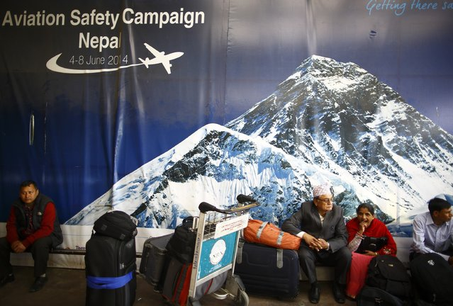 Stranded passengers wait at the Tribhuvan International Airport as the airport is closed after a Turkish Airlines plane overshot the runway in Kathmandu March 4, 2015. According to local media, all passengers and crew members of the flight were rescued. REUTERS/Navesh Chitrakar