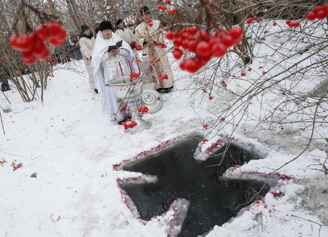 Priests take part in a religious ceremony during Orthodox Epiphany celebrations in Kiev, Ukraine, January 19, 2016. (Photo by Gleb Garanich/Reuters)