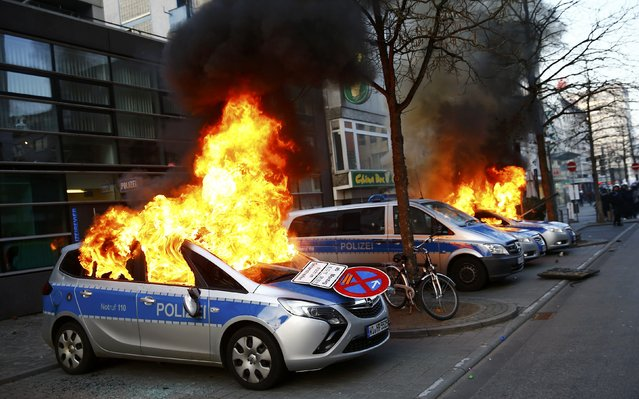 German police cars, set on fire by anti-capitalist protesters, burn outside the European Central Bank (ECB) building hours before the official opening of its new headquarters in Frankfurt March 18, 2015. (Photo by Kai Pfaffenbach/Reuters)