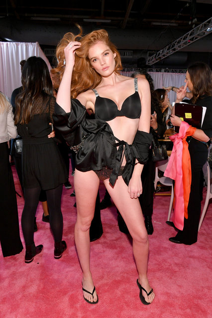 Alexina Graham prepares backstage during 2018 Victoria's Secret Fashion Show in New York at Pier 94 on November 8, 2018 in New York City. (Photo by Dia Dipasupil/Getty Images for Victoria's Secret)