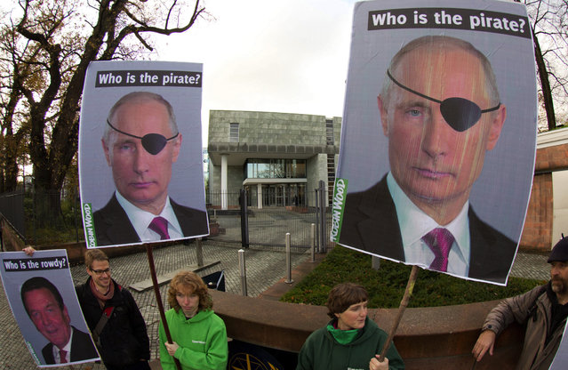 Activists of the environmental organization Robin Wood hold placards depicting Russia's President Vladimir Putin and former German Chancellor Gerhard Schroeder (L) as they demonstrate in front of the International Tribunal for the Law of the Sea in Hamburg, Germany, 06 November 2013. (Photo by Christian Charisius/EPA)