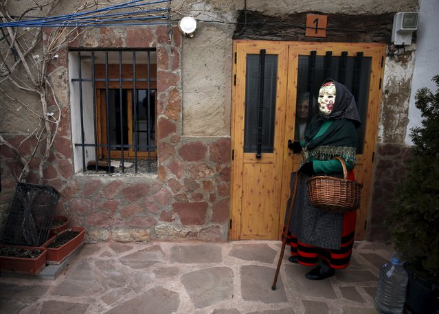 "A reveller, dressed as a ""Mascaritas"", attends carnival celebrations in the village of Luzon, Spain, February 6, 2016. (Photo by Sergio Perez/Reuters)"