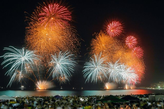 Fireworks explode over Copacabana beach during New Year celebrations in Rio de Janeiro, Brazil, January 1, 2017. (Photo by Marcelo Regua/Reuters)