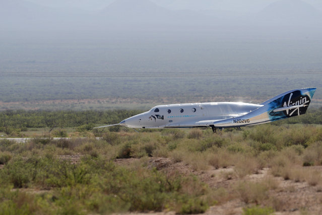 The Virgin Galactic rocket plane, with founder Richard Branson and other crew members on board, lands back in Spaceport America near Truth or Consequences, N.M., Sunday, July 11, 2021. (Photo by Andres Leighton/AP Photo)