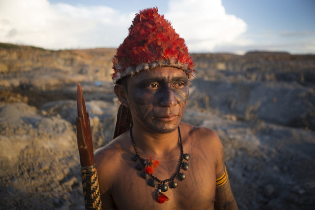 An indigenous man surveys the quarry site for the Belo Monte Dam. Belo Monte will be the world's third-largest dam and is facing strong resistance. On May 27th, an indigenous group made up of an alliance of indigenous groups occupied the dam and halted construction on the main turbine site. Studies show that the dam will displace up to 40,000 people in the Xingu Region. (Taylor Weidman)