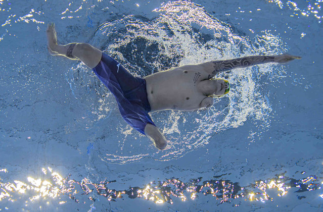 In this photo provided by Olympic Information Services, Talisson Henrique Glock, of Brazil, competes in the men's 200m individual medley SM6 swimming final in the Tokyo Aquatics Center during the Tokyo 2020 Paralympic Games in Tokyo, Japan, Thursday August 26, 2021. (Photo by Bob Martin/OIS via AP Photo)