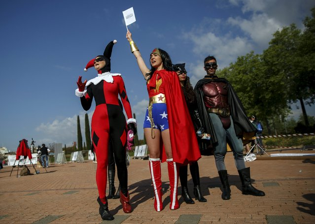 Participants wearing superhero costumes attend the World DC Comics Super Heroes event in San Martin de Valdeiglesias, near Madrid, April 18, 2015. To celebrate the anniversary of the publication of the very first Superman story, DC Comics are asking fans to help set a new world record for the largest global gathering of people dressed as DC Comics Super Heroes. (Photo by Andrea Comas/Reuters)