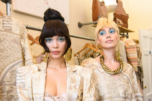 Models pose during the Paul Costelloe Presentation during London Fashion Week September 2021 on September 17, 2021 in London, England. (Photo by Matt Crossick/Empics Entertainment/Getty Images)
