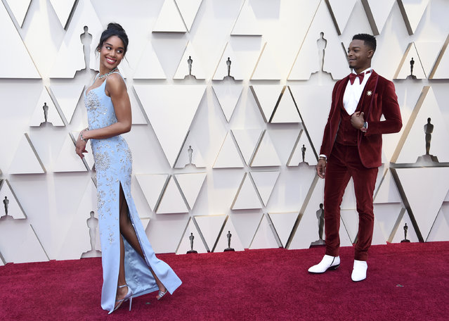 Laura Harrier, left, walks on the red carpet as Stephan James looks on at the Oscars on Sunday, February 24, 2019, at the Dolby Theatre in Los Angeles. (Photo by Richard Shotwell/Invision/AP Photo)