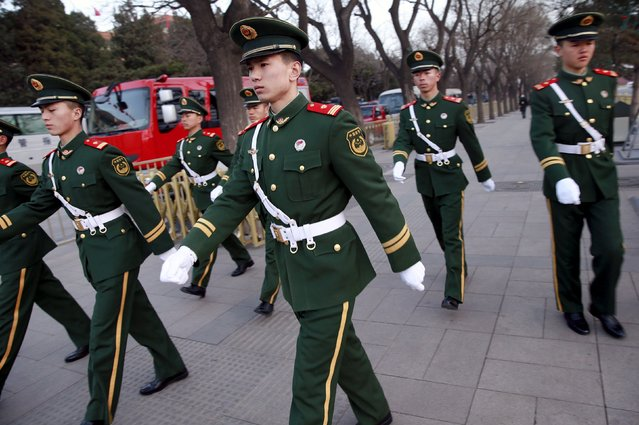 Paramilitary policemen march near the Great Hall of the People ahead of the opening session of the National People's Congress (NPC) in Beijing, China, March 5, 2016. (Photo by Kim Kyung-hoon/Reuters)