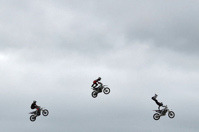 Bolddog Lings freestyle motocross stunt performers put on a display at the annual Balmoral agricultural show, which has returned after being cancelled last year due to coronavirus disease (COVID-19), in Lisburn, Northern Ireland, September 23, 2021. (Photo by Clodagh Kilcoyne/Reuters)