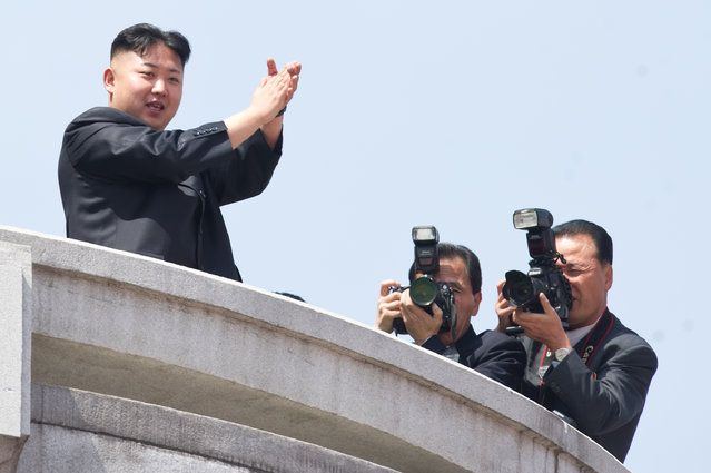 North Korean leader Kim Jong-Un (L) applauds during a military parade in honour of the 100th birthday of the late North Korean leader Kim Il-Sung in Pyongyang on April 15, 2012. (Photo by Ed Jones/AFP Photo)