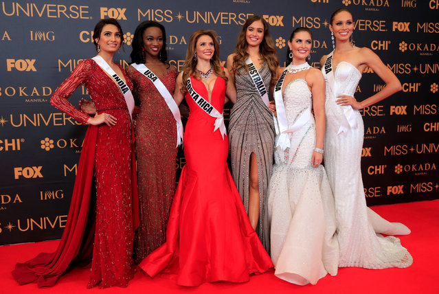 Miss Universe candidates pose for a picture during a red carpet inside a SMX convention in metro Manila, Philippines January 29, 2017. In Photo from L-R: Miss India Roshmitha Harimurthy, Miss USA Deshauna Barber, Miss Costa Rica Carolina Rodriguez, Miss Australia Caris Tiivel, Miss Canada Siera Bearchell and Miss Aruba Charlene Leslie. (Photo by Romeo Ranoco/Reuters)