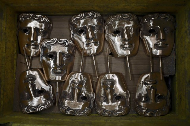 Partially completed bronze British Academy of Film and Television Awards (BAFTA) masks are seen at a foundry in west London, Britain January 31, 2017. (Photo by Stefan Wermuth/Reuters)