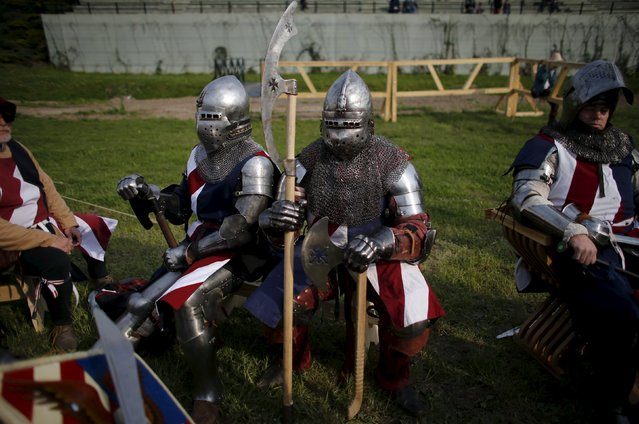 Members of U.S. team wait for the fights during break at the Medieval Combat World Championship at Malbork Castle, northern Poland, April 30, 2015. (Photo by Kacper Pempel/Reuters)