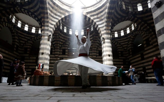 Dervish dancers performs during an event titled 'the Festival of the Syrian Bread held at Khan Asaad Basha in the old city of Damascus, Syria, on 01 April 2019 to commemorate the Syrian New Year according to the Syrian culture. The event is held under the auspices of the Syrian Tourism Ministry with the cooperation of the Union of Craftsmen. (Photo by Youssef Badawi/EPA/EFE)