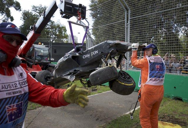 Formula One, Australia Grand Prix, Melbourne, Australia on March 20, 2016: The McLaren of F1 driver Fernando Alonso is retrieved following a crash with Haas F1 driver Esteban Gutierrez at the Australian Formula One Grand Prix in Melbourne. (Photo by Mark Horsburgh/Reuters)