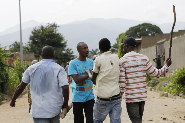 Demonstrators protesting against President Pierre Nkurunziza's decision to seek a third term in office confront a man in the Cibitoke district of Bujumbura, Burundi, Thursday May 7, 2015. (Photo by Jerome Delay/AP Photo)