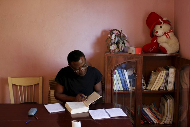 Howard Jackson, a Liberian migrant, studies at his home in the Andalusian capital of Seville, southern Spain March 11, 2016. (Photo by Marcelo del Pozo/Reuters)