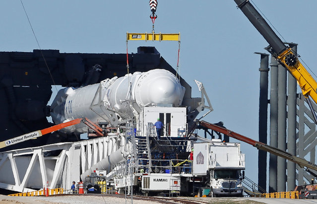A SpaceX Falcon 9 rocket, in a horizontal position, is readied for launch on a supply mission to the International Space Station on historic launch pad 39A at the Kennedy Space Center at Cape Canaveral, Florida, U.S., February 17, 2017. The launch is scheduled for February 18. (Photo by Joe Skipper/Reuters)