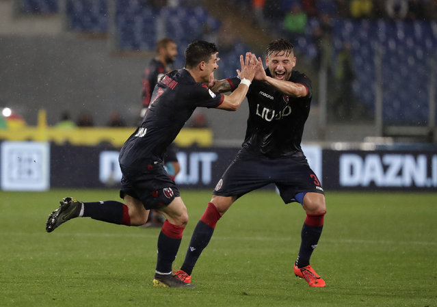 Bologna's Riccardo Orsolini, left, celebrates with Bologna's Giancarlo Gonzalez after scoring his side's third goal during an Italian Serie A soccer match between Lazio and Bologna, at the Olympic stadium in Rome, Monday, May 20, 2019. (Photo by Andrew Medichini/AP Photo)
