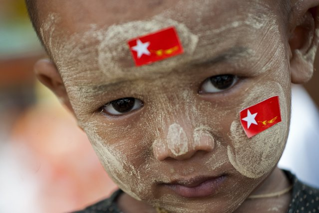 A child looks on as supporters of Myanmar opposition leader Aung San Suu Kyi attend a public gathering at Than Phyu Zayat township in Mawlamyaing, Mon State on May 17, 2015. (Photo by Ye Aung Thu/AFP Photo)