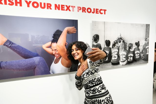 "Actress Tracee Ellis Ross snapped a selfie during Special K ""Nourish Your Next"" project recipient Kate T. Parker's photography exhibit at Sky Gallery in New York City on March 16, 2016. (Photo by Stuart Ramson/Invision for Kellogg's Special K/AP Images)"