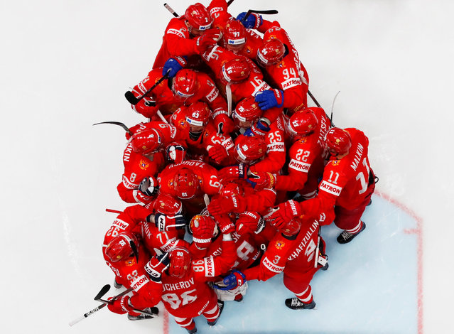 Russia's players celebrate after winning the Men's Ice Hockey World Championships bronze medal match between Russia and Czech Republic in Bratislava, Slovakia on May 26, 2019. (Photo by David W. Cerny/Reuters)