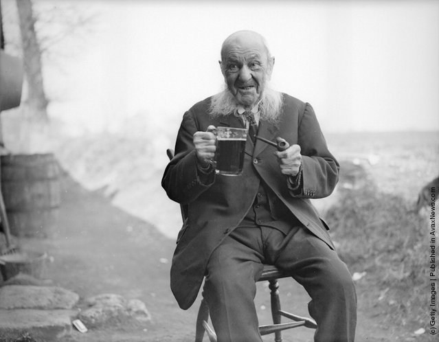 1932: 104-year-old John Faulkner of Appleford, Berkshire enjoys a pipe and a glass of beer as he remembers his considerable past. A former jockey, he has been married twice and fathered 32 children