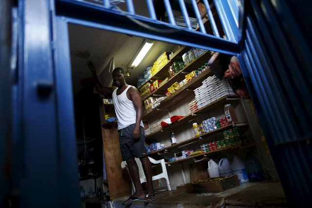 An inmate stands in one of the shops at the Pavilion No.6 assigned to foreigners at La Joya prison on the outskirts of Panama City, Panama January 29, 2016. (Photo by Carlos Jasso/Reuters)
