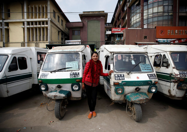 """Januka Shrestha, 25, a Tuk Tuk driver, poses for a picture in Kathmandu, Nepal, February 26, 2017. """"There is no difference in a vehicle driven by a woman and man. While driving on the road people sometimes try to dominate a vehicle especially when they see a woman driving it. People have even used foul language toward me. When this happens I keep quiet and work even harder to prove that we are as capable as men"""", Shrestha said. (Photo by Navesh Chitrakar/Reuters)"""