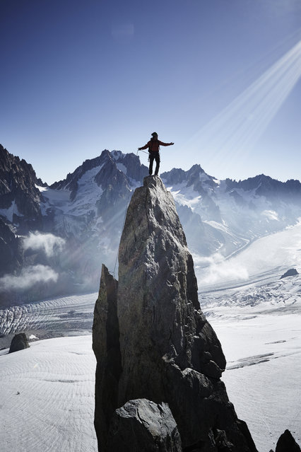 """""""Climber"""". Climbers are creatures that climb high up toward the heavens, and their hands are tools for grabbing hold of the summit. Photo location: Argentiere, France. (Photo and caption by Yosuke Kashiwakura/National Geographic Photo Contest)"""