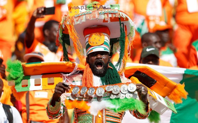 An Ivory Coast's fan cheers for his team prior to the 2019 Africa Cup of Nations (CAN) football match between Ivory Coast and South Africa at the Al Salam Stadium in Cairo on June 24, 2019. (Photo by Mohamed Abd El Ghany/Reuters)