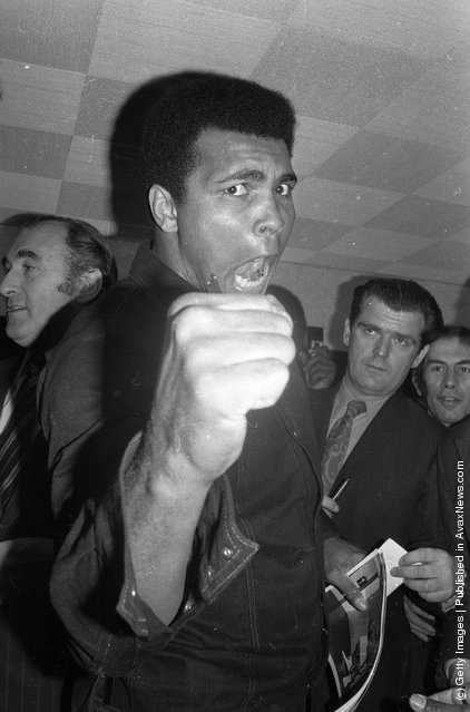 1974: American boxer Muhammad Ali, formerly Cassius Clay, strikes an aggressive pose at a press conference