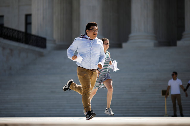 News assistants run outside the U.S. Supreme Court after the court rejected efforts to rein in the contentious practice of manipulating electoral district boundaries to entrench one party in power by turning away challenges to political maps in Maryland and North Carolina, in Washington, U.S., June 27, 2019. (Photo by Carlos Barria/Reuters)